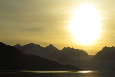 Picture of the midnight sun during summer over a fjord; north-western Svalbard. By Eike Stübner